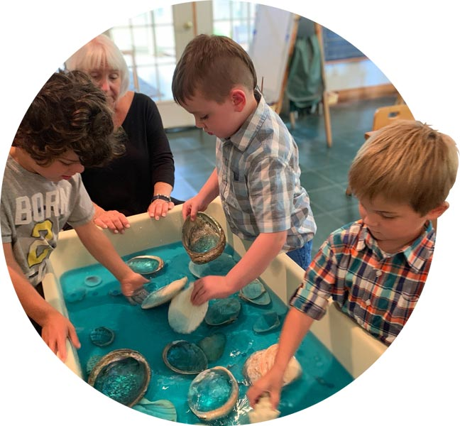 Kindergartners playing with the water table