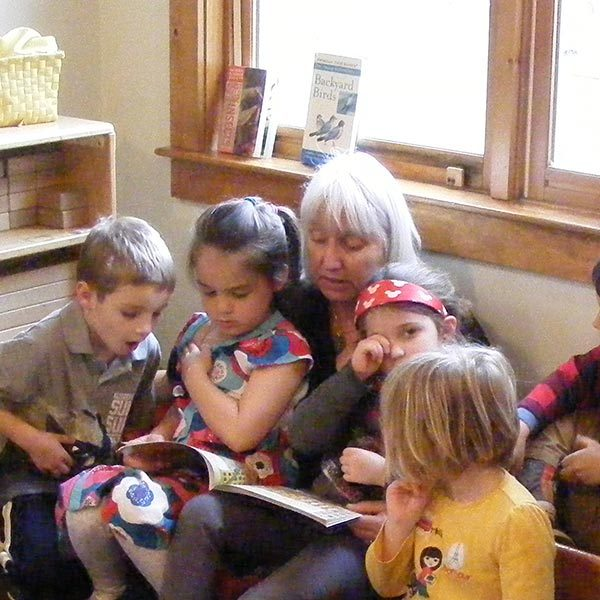 Bambi Urann reading to students