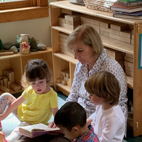 Mary Ann Carter Reading to students